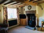 Living room with original beams and log burning stove
