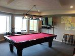 Rec Room with pool table, PS4 and games, TV with DirectTV and Roku.