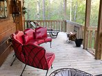 Relax on the back deck taking in the mountain air with the sounds of nature.