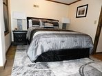 Second queen bedroom on lower floor has small fridge and coffee service.