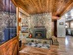 Open floor plan with beautiful hardwood floors throughout
