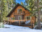 Classic A-frame Tahoe cabin with updated amenities. The property is set in a beautiful, green, wooded area