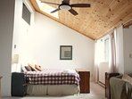 Queen bedroom with cathedral ceilings