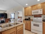 Granite counter tops in this full equipped kitchen.