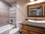 The shared guest bathroom upstairs has a combination shower/tub and fine bath fixtures.