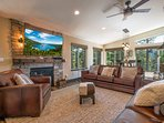 The main living area offers a large, flatscreen TV and gas fireplace.