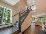 From the first floor family room, take the staircase to enter the open space of the second floor living area.