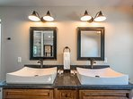 The Master Bathroom features a double vanity with contemporary sink designs.