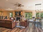 The living area, dining room, and kitchen all share an expansive open floor plan making it easy to gather in big groups.