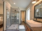 A sleek stand-alone shower in the Master Bathroom was designed with a distressed-wood look.