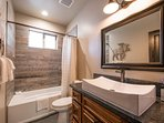 Downstairs, there's a second guest bathroom with a combination shower/tub.