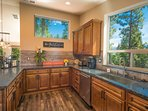 The kitchen has spectacular views, as well as plenty of space for preparing meals.