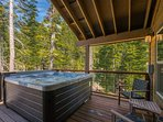 The private hot tub is located on the second-floor deck and is ideally placed amid the soaring pines.