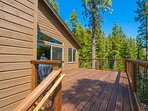 A separate second-story deck has a grill and plenty of space for large groups.