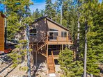 The home is a classic South Lake Tahoe traditional cabin set in the thick pine trees.