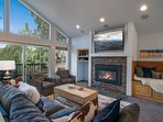 Floor-to-ceiling windows let natural light pour into the main living room.