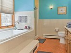 This en-suite bathroom features a large soaking tub.
