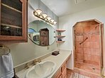After a long day out on the trails, wash up in this spacious walk-in shower.