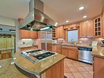 With plenty of counter space, meal preparation in this space is easy as pie.