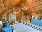 This bedroom also houses a king-sized bed.
