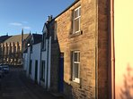 Early morning sun on The Cottage, looking down the street to Dunblane Cathedral.
