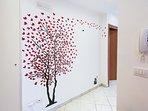 CORRIDOR: red tree decoration