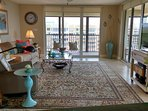 Living Room overlooks a screened corner lanai