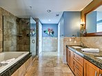 Get ready for the day in the en-suite master bathroom.