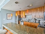 Three guests can sit at the breakfast bar while the chef whips up some treats.