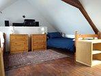 Open-plan twin bedroom upstairs