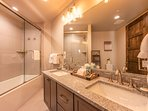 Private Bath with Dual Sinks and a Tub / Tile Shower Combo