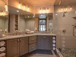 Master Bath with Dual Sinks with a Quartz Counter, and a Tile / Stone Shower