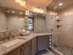 Master Bath with Dual Sinks and a Tile / Stone Shower