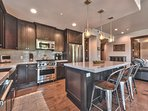 Fully Equipped Gourmet Kitchen with Quartz Counters, Viking Stainless Steel Appliances, including a Gas Range, and...