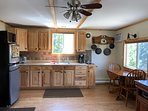 Kitchen in Main Cabin. Toaster oven, coffee maker, 2 burner propane stovetop, & all dishes/cutlery.