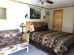 Queen bed and walk-in closet in Family Cabin.