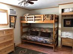 Twin upper and full size futon lower bunk in Bunk Cabin.