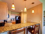 Fully equipped kitchen with granite counter tops, breakfast bar and everything you need from coffee maker to blender