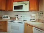 Completely outfitted kitchen with modern appliances including dishwasher.  Food Market close by too.