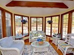 Beautiful sunroom off the open kitchen and dining room