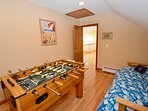 Game room with foosball and futon