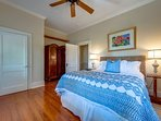 Master bedroom with queen size bed with lovely sunrise views over the water in the morning.