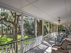 Expansive porch area to relax, enjoy meals & grill.