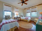 Guest room with twin beds with views overlook 10 acre pasture & marsh