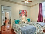 This room offers a set of twin beds.