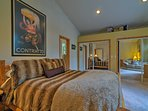 Two guests can claim the plush queen bed in the master bedroom!