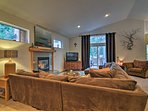 The large living room has a fireplace, TV, and access to the deck!