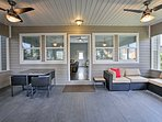 This screened porch is the perfect place to enjoy a nice meal.