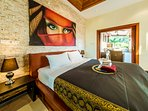 Downstairs King Master Bedroom En Suite with private terrace and dipping Jacuzzi Pool