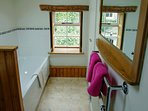 Bathroom with toilet, basin and bath with hand shower